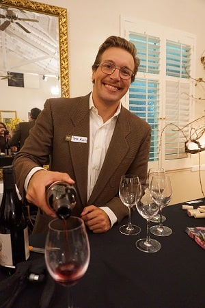 Peter Koros, part of the next generation of the Fotinos Family, pours wine at their 50th anniversary celebration. IMAGE: FOTINOS VINEYARD