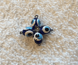 Jewel School: Mati charm in the shape of a cross