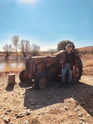 Margaret Fotinos shows her beloved grandfather's tractor, lovingly displayed in the vineyard. IMAGE: MARIA A. KARAMITSOS