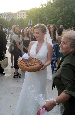 Eleni Gage throwing a bread at her wedding
