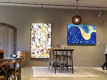 The cozy tasting room also boasts the work of another Greek – San Diego-based artist Amy Koumaras. Her bold use of color adds panache to the rustic decor. IMAGE: MARIA A. KARAMITSOS